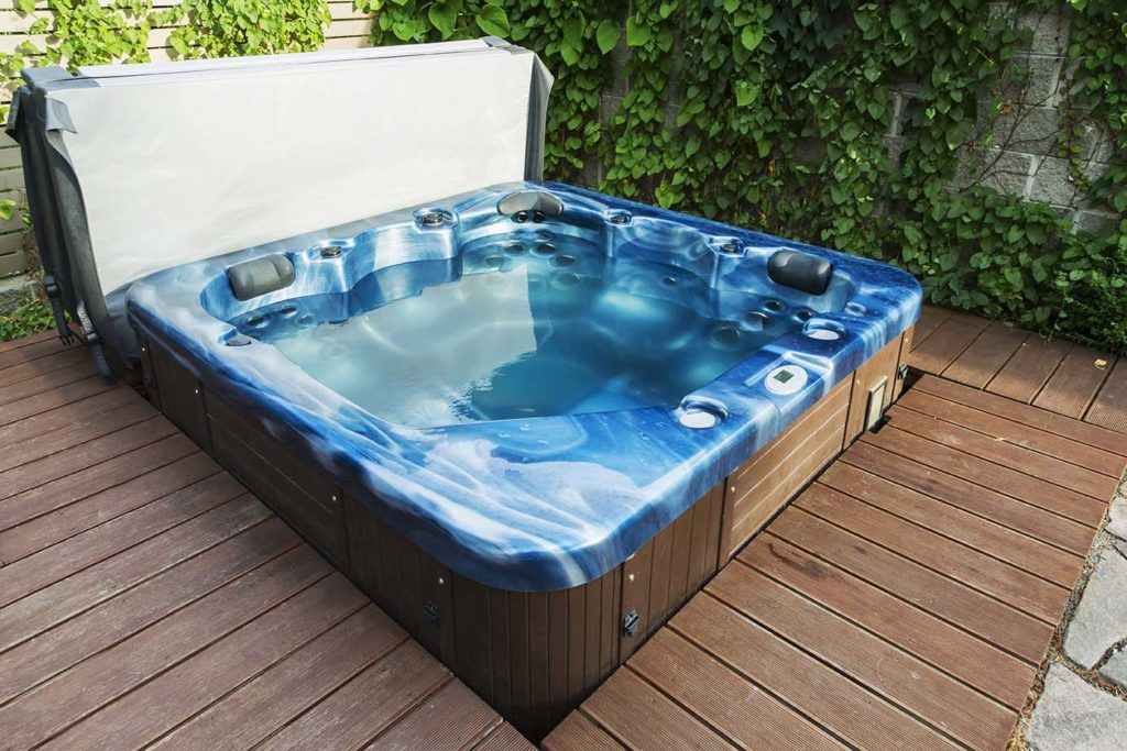 Outdoor hot tub, jacuzzi on the garden.